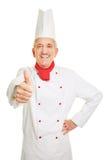 De de kokholding van de chef-kok beduimelt omhoog Royalty-vrije Stock Fotografie