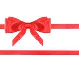 De de rode knoop en linten van de satijnboog op wit - reeks 24 Royalty-vrije Stock Afbeelding