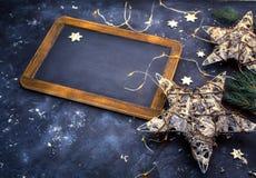 De decoratie en het bord van de Kerstmisvakantie Royalty-vrije Stock Afbeeldingen