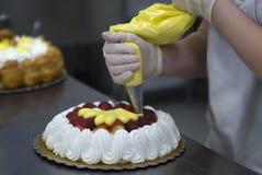 De decoratie van de cake Stock Foto's