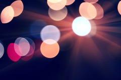De decoratie van Defocusedlichten in nachtstad Stock Afbeelding