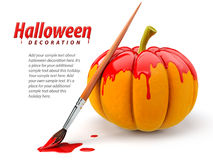 De decoratie van Halloween met borstel het schilderen pompoen Stock Foto's