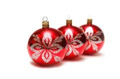 De decoratie van Kerstmis - drie rode ballen in rij Stock Afbeelding