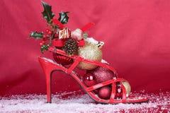 De decoratie van Kerstmis over rood Stock Afbeeldingen
