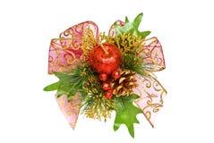 De decoratie van Kerstmis - pijnboomtak, appel en boog Stock Foto