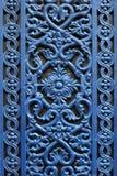 De decoratieve deur van het venstermetaal met een bloem stock foto