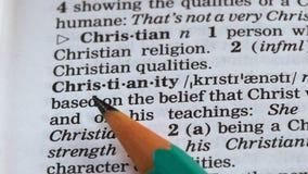 De definitie van het christendomwoord in woordenboek, één van hoofdgodsdiensten, geloof wordt geschreven dat stock footage