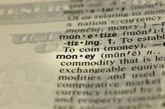 De definitie van het geld met opgelegde achtergrond Stock Afbeeldingen