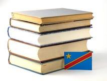 De democratische Republiek van de vlag van de Kongo met stapel van boeken isoleert Royalty-vrije Stock Fotografie