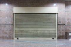 De deur van het rolblind en de achtergrond van het muurgraniet Royalty-vrije Stock Fotografie