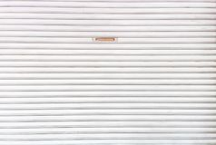 De deur van de witmetaalrol Stock Fotografie