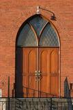 De deuropening van de kerk Stock Afbeeldingen