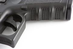 De dichte omhooggaande trekker van het pistool Royalty-vrije Stock Afbeeldingen