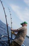 De diepzee visserij van de mens stock foto's