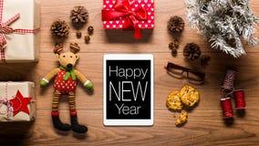 De digitale tablet en stelt, nieuw jaarconcept voor Stock Afbeelding