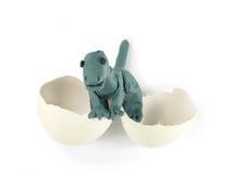 De dinosaurus en het ei van de plasticine Stock Fotografie
