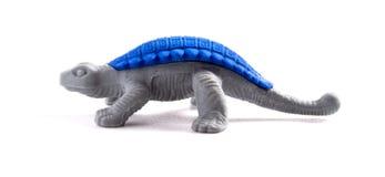De dinosaurus van het stuk speelgoed op witte achtergrond royalty-vrije stock foto's