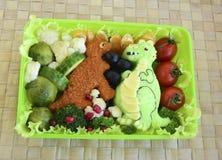 De dinosaurus wordt gemaakt van rijst Kyaraben, bento Stock Foto