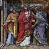 De discipelen ontmoeten Jesus op de weg aan Emmaus Royalty-vrije Stock Afbeelding