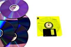 De disco flexível e cd amarelos Imagem de Stock Royalty Free