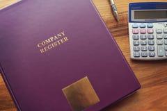 De documenten van het bedrijfregister met pen en calculator royalty-vrije stock fotografie