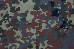 De doektextuur van het camouflagepatroon Abstracte achtergrond en textuur voor ontwerp stock foto's