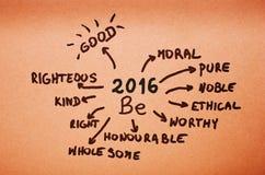 De doelstellingen op 2016 worden geschreven op oranje karton Royalty-vrije Stock Foto's