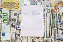 De doelstellingen van het nieuwjaar zijn resoluties met euro en dollar Stock Afbeelding