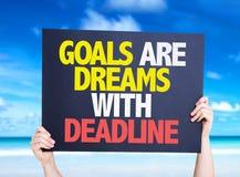 De doelstellingen zijn Dromen met Uiterste termijnkaart met aardachtergrond Stock Foto's