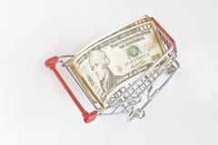 De Dollar van de V.S. in het karretje Stock Foto's