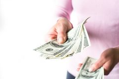 De dollar van het contant geldgeld in handen Stock Fotografie