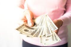De dollar van het contant geldgeld in handen Royalty-vrije Stock Foto's