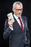 De dollarbankbiljetten van de zakenmanholding Stock Foto