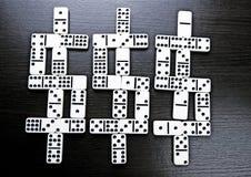 De dollars van de domino Stock Foto's