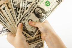 De dollars van de holding Stock Afbeeldingen