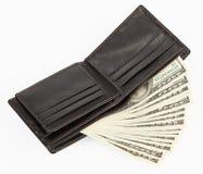 De dollars van de V.S. in een zwarte beurs Stock Foto's
