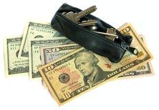 De dollars van de V.S. en sleutels Stock Afbeeldingen