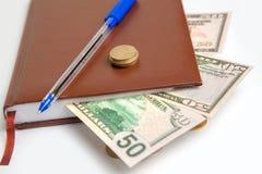 De dollars zijn in blocnote Royalty-vrije Stock Fotografie