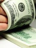 De dollarsclose-up van het hand tellende geld Stock Afbeelding