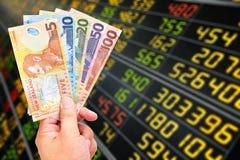 De dollarsrekening van Nieuw Zeeland op effectenbeursachtergrond Royalty-vrije Stock Afbeeldingen