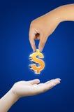 De dollarsymbool van de handholding Stock Fotografie