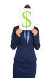 De dollarteken van de onderneemsterholding voor gezicht Royalty-vrije Stock Foto