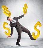 De dollartekens van de zakenmanholding Royalty-vrije Stock Foto
