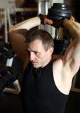 De domoor van de tricepsgewichten van de opleiding Royalty-vrije Stock Fotografie
