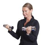 De domoren van het vrouwengewichtheffen Stock Foto