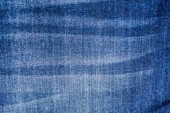De donkerblauwe achtergrond van de jeans materiële textuur Royalty-vrije Stock Afbeelding
