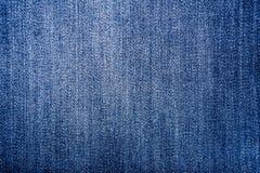 De donkerblauwe achtergrond van de jeans materiële textuur Stock Foto