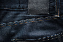 De donkerblauwe achtergrond van de jeansstof Royalty-vrije Stock Afbeelding