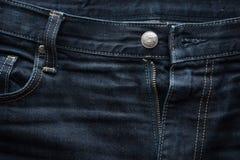 De donkerblauwe achtergrond van de jeansstof Stock Afbeelding