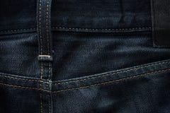 De donkerblauwe achtergrond van de jeansstof Royalty-vrije Stock Fotografie